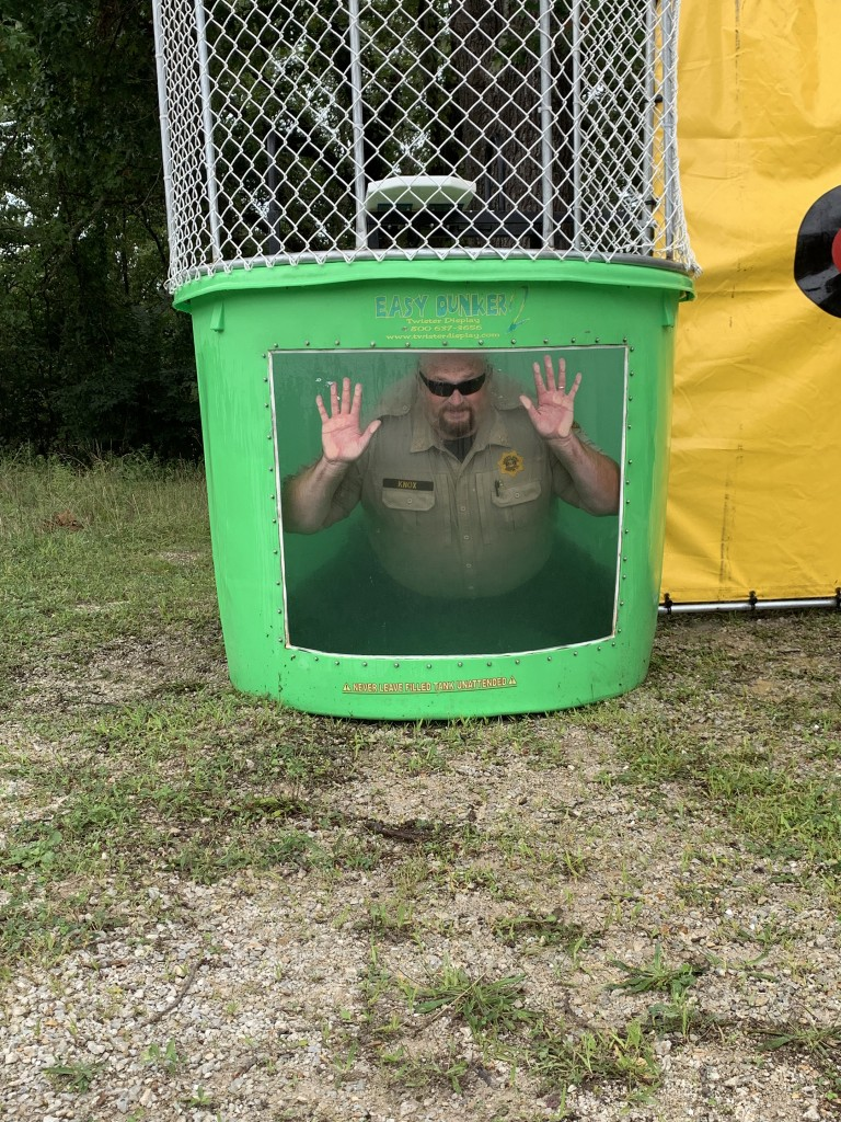 GETTING DUNKED for a good cause, Benton County Sheriff Eric Knox took part in the dunking booth during Saturday's Edwards Summer Fling. Proceeds from the event are used for scholarships to benefit area students.