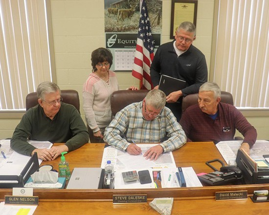 COUNTY COMMISSIONERS Glen Nelson, Steve Daleske and David Malecki signed a State of Emergency order on Tuesday. The coronavirus pandemic is impacting  the  area with closures that include schools, churches and the food pantry. County Clerk Susan Porterfield and Emergency Management Director Mark Richerson were present during the signing.