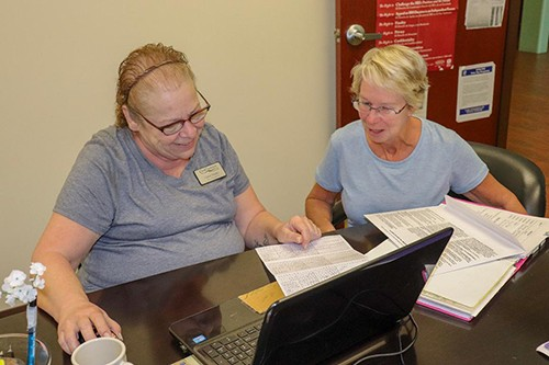 MAJOR CHANGES to tax laws have impacted Missourians across the state. Tax Volunteer Carol Snider helped Sue Ann Mische with her taxes at Harbor Village on Tuesday.