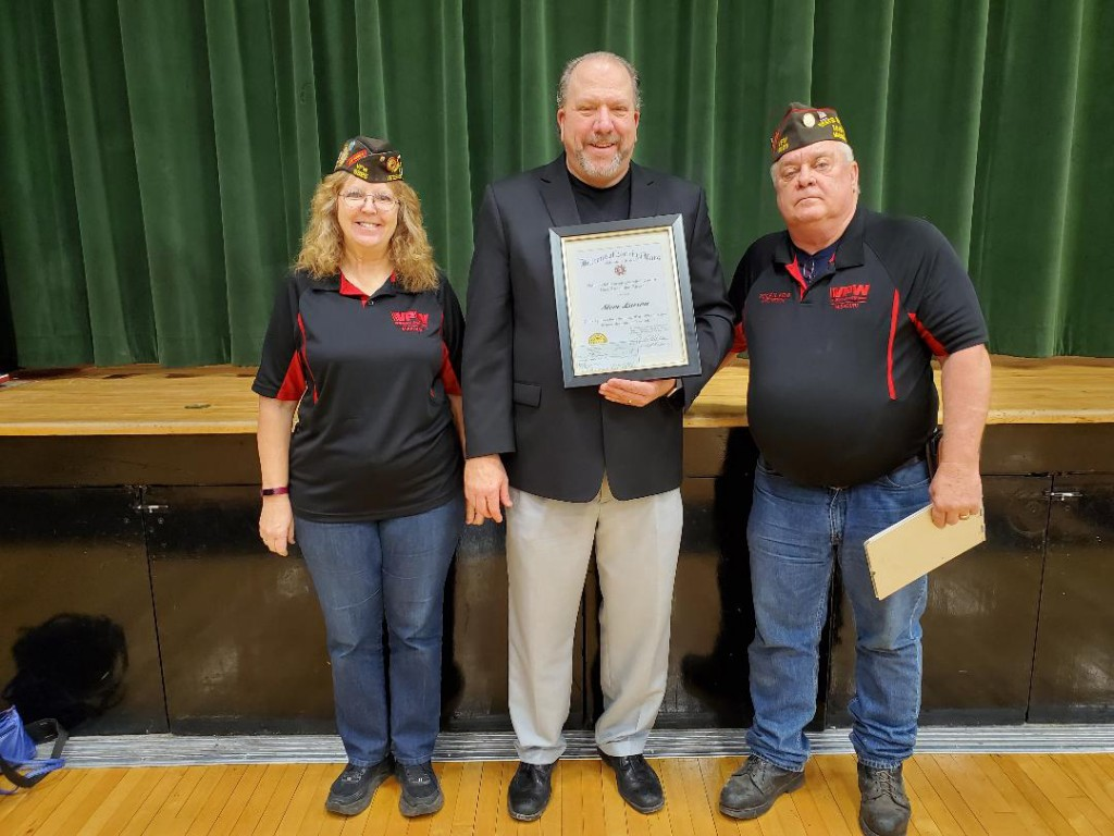 HONORING AN EXCEPTIONAL educator, the Lincoln VFW presented Warsaw R-IX Instructor Steve Larson with the Smart/Maher Teachers Award. Attending the presentation with Larson was Scholarship Chairman Susan Kelb and Lincoln VFW Post Commander Royce Kelb.
