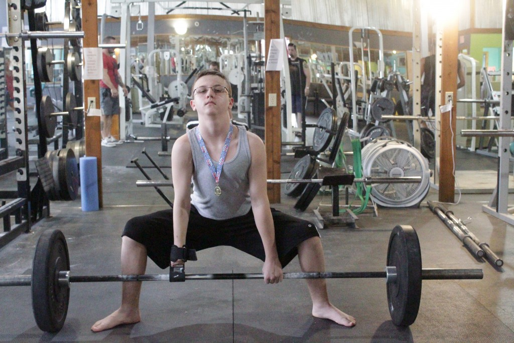 AN UNSTOPPABLE SPIRIT, Dakota Todd wore the second place medal he recently won at a power lifting event during a workout. Todd was born with a birth defect called Poland Syndrome and is missing both his right hand and his right pectoral muscle.