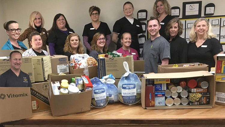 GIVING THE GIFT OF FOOD, Truman Lake Dental spear headed a reverse advent calendar program to help the Benton County Food Pantry.