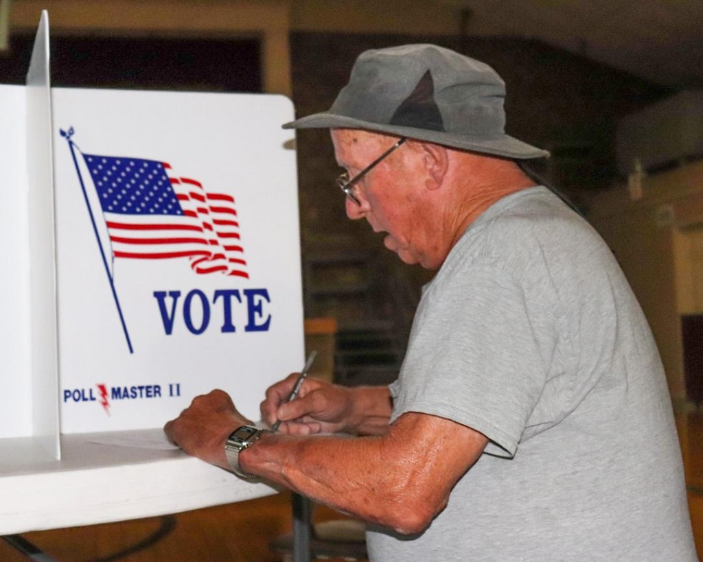 VOTERS HEADED TO PRIMARY POLLS on Tuesday despite the pandemic.  James Henson cast his ballot at the Warsaw Community Building where voting turnout was heavy.