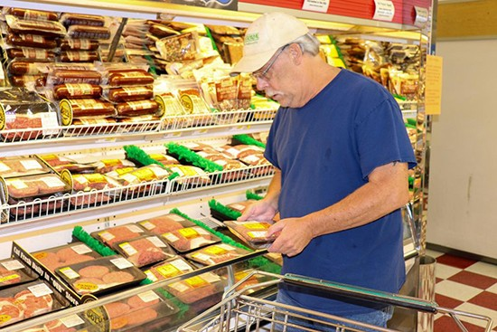 """SOARING MEAT PRICES AND SCARCITY have hit Benton County residents as processing plants have closed due to Covid-19.  Tom Williams shopped for ground beef  at G&W Country Mart. He told the Enterprise, """"Meat is a necessary item like gasoline, except the price isn't dropping."""""""