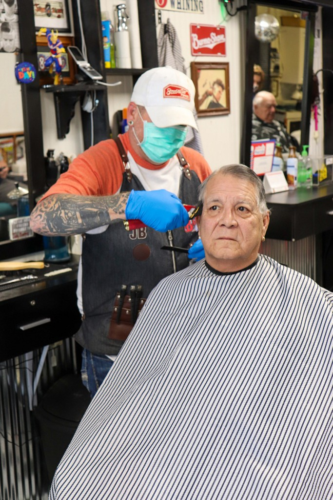 ON THE LONG ROAD TO RECOVERY, area businesses are beginning to open after coronavirus restrictions have been eased. Duane and Martha Robinson were among diners at Cow Patties Restaurant. Jody Bates at The Main Street Barber Shop saw clients on Tuesday including Bob DeLaGarza. Both establishments have been shuttered for the past several weeks.