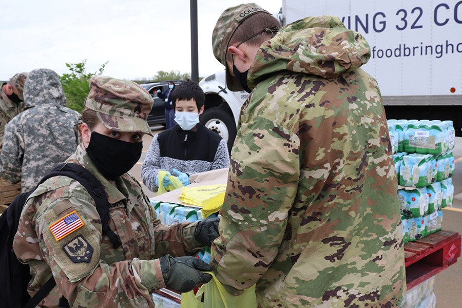 THE DEMAND FOR FOOD ASSISTANCE has sky rocketed as people have been laid off or lost their jobs due to the coronavirus. Sergeant Feaginn, Pahanna Daffron and Specialist Colston helped distribute food at Harbor Village.