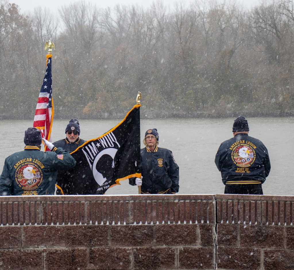 BITTER COLD didn't stop Benton County residents from honoring veterans with the annual Wreathing of the Waters ceremony on Monday at Drake Harbor. Mark Mills, David Carr, Andrea Larimer  and Mike Lange were part of a contingent from American Legion Post #217 taking part in the ceremony.
