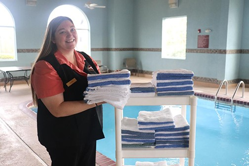 ON THE FRONT LINES of Warsaw's expanding tourism economy, Felecia Davis at Parkfield Inn prepared the pool for arriving guests on Tuesday. The City of Warsaw has been recognized for it's efforts to spur tourism, receiving the Innovator Award at the Governor's Conference on Tourism.