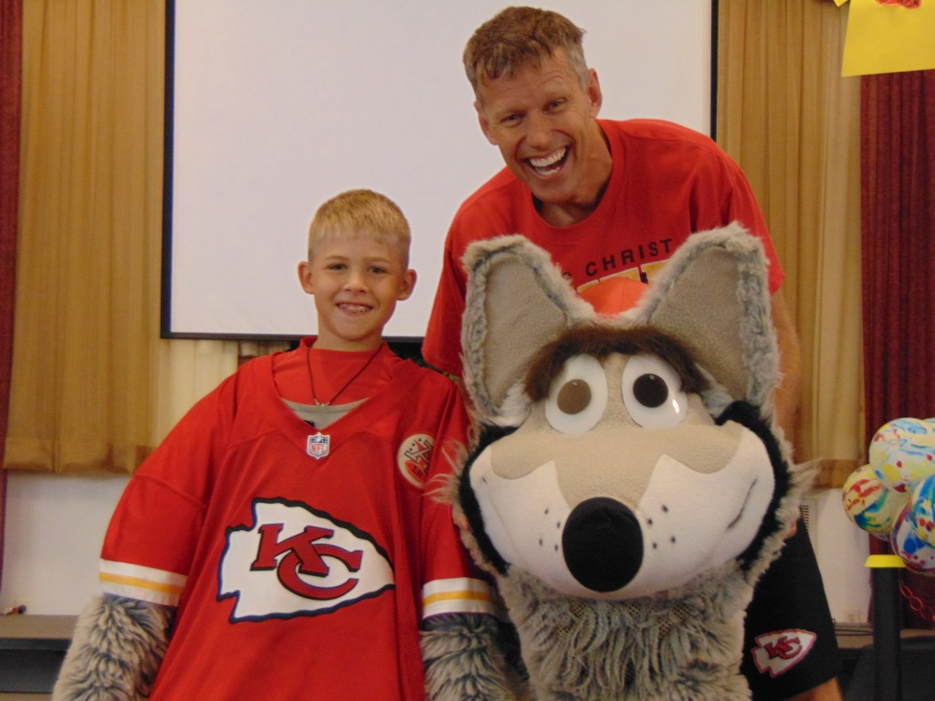 MAKING A SURPRISE APPEARANCE, KC Wolf  met with vacation bible  school students at Cedar Grove Baptist Church. The official mascot of the Kansas City Chiefs let Reed Bagley try on the costume for size.