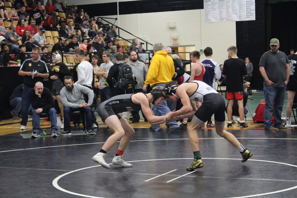 WARSAW FRESHMAN NICK BAGLEY grappled his way to a fourth place finish at last Saturday's Warsaw Wrestling Invitational Tournament. Bagley is 12-4 on the season and is eyeing a state tournament berth in his first season with the Wildcats. Photo courtesy of Nicole Jeffery, The Wildcat.